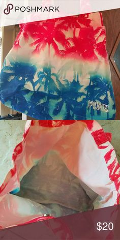 PINK Beach Bag Super cute pink white and blue tye dye affect with palm trees. Got as a gift, never used. It has two front pockets and is very spacious. Material can get wet. PINK Bags Totes