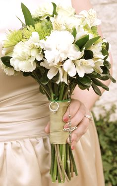 My bouquet from our Renewal - with my grandmother's rosary and Trey's grandmother's wedding rings tied into the flowers!