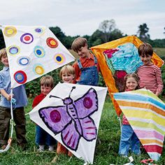 Is it too much to have kids decorate a paper shaped kite? This would personalize it, could be smaller.