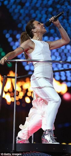 Melanie Chisholm (AKA Sporty Spice) in a crisp white jumpsuit.