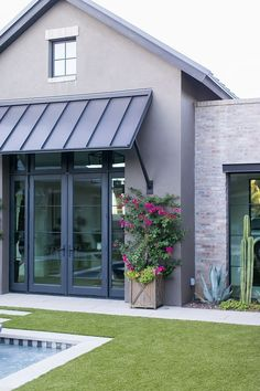 Exterior Grey stucco with Brick metal roof and black steel doors and windows Exterior brick is General Shale Ironworks - October 26 2019 at Stucco Exterior, Stucco Homes, Grey Exterior, Modern Farmhouse Exterior, House Paint Exterior, Exterior Design, Farmhouse Ideas, Black Windows Exterior, Cafe Exterior