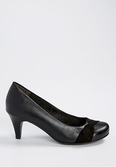 <ul><b>Overview</b><li>wide width footbed</li><li>extra cushioning in heel and arch</li><li>faux leather upper</li><li>ribbon toe decoration</li><li>soft heel lining for comfort</li><li>low heel is perfect for everyday wear</li></ul>  <ul><b>Sizing</b><li>2 1/2 inch heel</li></ul>  <ul><b>Fabric and Care</b><li>Style Number: 52779</li><li>Imported</li><li>Man made materials</li><li>Wipe clean</li></ul>