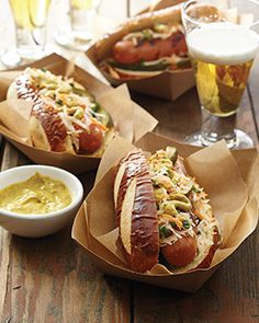 Kick off 4th of July with a spread of hot dogs and all their fixin's including mustardy Pretzel Dogs and spicy Buffalo Dogs.