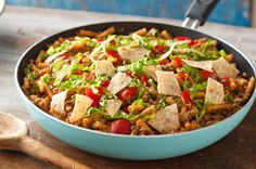This delicious all-in-one skillet dish is sure to be a crowd pleaser. Simply, combine ingredients and stir.