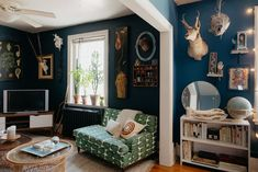 A Nature Illustrator's Virginia Rental Home Is a 'Modern Victorian Surrealist Cabinet of Curiosities' Living Room Photos, Bedroom Photos, Living Spaces, Bedroom Ideas, Dark Paint Colors, Navy Walls, White Walls, Cabinet Of Curiosities, Modern Victorian