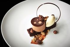 Milk chocolate mousse, chocolate cake, hazelnut ice cream, chocolate-covered candied hazelnuts, chocolate sauce and dark chocolate cremeux by Aggie Chin, Executive Pastry Chef of Capella Hotel in Washington D.C.
