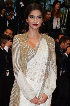 Sonam Kapoor in a Anamika Khanna Couture lace gown. The 66th Annual Cannes Film Festival Opening Ceremony, 2013.