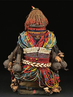 Africa | Fali doll from northern Cameroon | Wood, glass beads, leather strip, cowrie shells, coins, leather amulets, cloth
