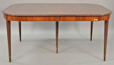 Margolis mahogany Federal style table with D shape ends on square tapered legs with line and bellflower inlays have three leaves.  lg. 66in.; wd. 45in.; ht. 30in.; two leaves 24in. each, total length 114in.  Estimate: $400 - $800