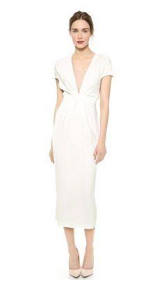 41 Edgy Modern Wedding Ideas You'll Love: short sleeve midi dress with a plunging neckline