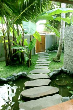 Ubud Villa Jo designed and built by Warren and Robbin Entry stepping stones over lotus pond