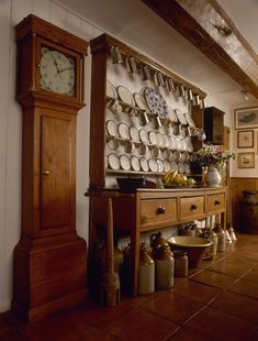 Wonderful dresser and beautiful Grandfather clock. This is so gorgeously English. Just as I like it.
