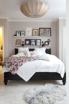 creative shelving over a bed with a low headboard - nice bed too