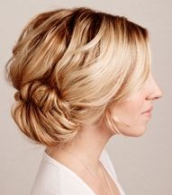 This tucked chignon works because it balances the volume at the nape of the neck with a boost at the crown.