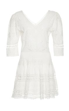 100% cotton  his LoveShackFancy Paige Crochet Mini Dress features a v neckline with long sleeves, a drop waist and a pleated skirt.  Product Details  Half sleeves  Pleated shoulder detail  Partially Lined  Composition: 100% cotton  Color: ivory  Zipper  Imported  Product Code 633451