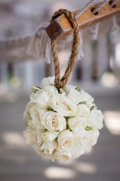 THESE kissing balls Stephanie for the flower girls!!!! Not sure about the flower choice but I want the rope handle!