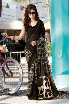 Shop SIXMETER #Casual Wear Black Georgette Saree at 99trendz.com. This is a perfect addition to every women's #Sarees Collection.