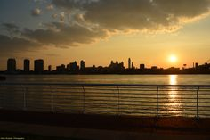 Sunset across the Delaware River from the Camden Waterfront, looking at Philadelphia's skyline.