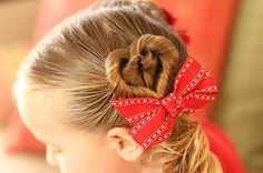 cute heart hair! -- Looks young with that bow, but if it could be done at the nape of the neck, it could look really sweet as part of a wedding hair-do.