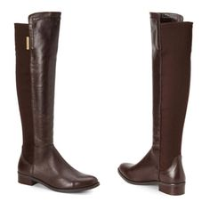 """Vince Camuto Brown Stretch Knee High Riding Boots Sizing: True to size.  - Almond toe - Contrast construction - Topstitched detail - Elastic back detail - Pull-on - Stacked heel  - Approx. 19"""" shaft, 14 1/2"""" opening circumference - Approx. 1 1/4"""" heel - Brand new without box  Materials: Leather/fabric upper, manmade lining and sole Vince Camuto Shoes Winter & Rain Boots"""