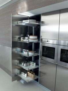 Accessories An extensive selection of technically advanced organizational elements and accessories maximize the efficiency of your new kitchen with same high level of detail and finish quality expected from all Pedini products. Wood, stainless steel, aluminum, glass and chrome pieces assure that everything has a place with easy access and visibility. Accessories for tall units...