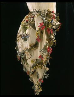 Great Britain (made)  1760-1765 (made)   1735-1749 (embroidered)  Silk and linen, hand woven and hand sewn, silver, gold, parchment