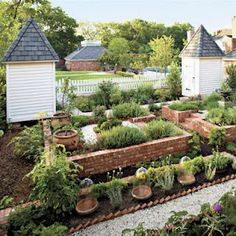 Delightful brick raised bed garden and detatched turrets (sheds) to match a vintage home.