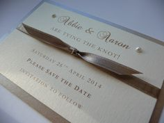 "Ivory and Gold ""Tying the Knot"" themed Save the Date idea"