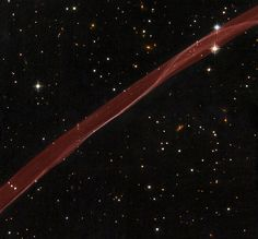 Hubble Sees Stars and a Stripe in Celestial Fireworks | A delicate ribbon of gas floats eerily in our galaxy. A contrail from an alien spaceship? A jet from a black-hole? Actually this image, taken by NASA's Hubble Space Telescope, is a very thin section of a supernova remnant caused by a stellar explosion that occurred more than 1,000 years ago.