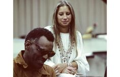 Barbra and Ray Charles.