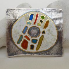 Zsuzsi Morrison | Fragments brooch from graffiti series ... this one at DazzleOXO