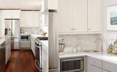 Mmmm... love this look. Classic with a little bit of sparkle.  Also, I like having the microwave lower than the upper cabinets - countertop appliance garage or just below the counter is the way to go if you've got kids that are just getting old enough to use it.  Webisode Kitchen After - Sarah Richardson and Lowe's Renovation