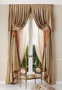 These curtains, layered over a pair of sheer panels, are pulled up at a high, sharp angle to reveal a contrasting fabric on the exterior side.