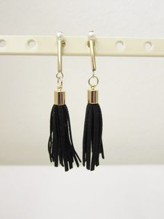 Glam black tassle earrings ($12.50) The trendy dangling tassle earrings enhance the glamorous vibe of your outfit. A go-to piece for anyone who wants to pull off elegant and modern looks. Made in Korea.
