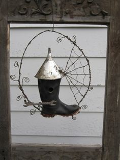 Rustic rubber boot and barbed wire birdhouse...