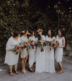 Boho bridesmaids in white lace dresses