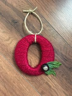 Lets go, Bucks! Get your OSU ornament today! Perfect for any fan, alum, or to give as a gift (think stocking stuffer!). This listing is for a single Buckeye O that has been carefully hand wrapped in your choice of yarns. The Gray sparkly option is shown in picture 5 and has the same subtle level of shine as the maroon sparkly option. My apologies that my camera did not pic up on the shine. A piece of rustic jute cording is attached for easy hanging. Finally, silk leaves accent a real…