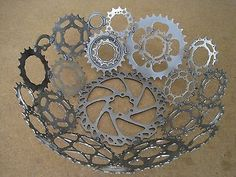 These bowls are made from bicycle gears and sprockets that have been taken off of bicycles because they have reached the end of their designed purpose life. The parts have been thoroughly cleaned and