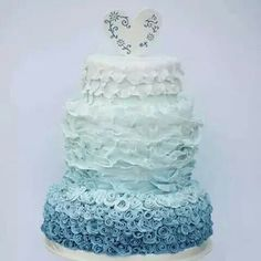 White to blue ombre ruffle & rose cake