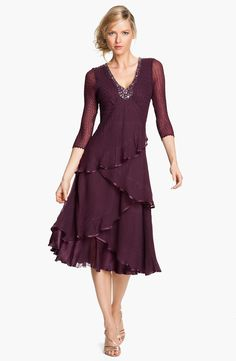 Free shipping and returns on Komarov Embellished Tiered Chiffon Dress at Nordstrom.com. Delicately textured chiffon shapes the opulently embellished bodice and whimsically tiered skirt of a V-neck fit-and-flare dress finished with gleaming charmeuse trim and gossamer sleeves.