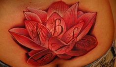 Absolutely beautiful red lotus lower back piece with an English alphabet on each petal representing those, who are close to heart.   love the idea