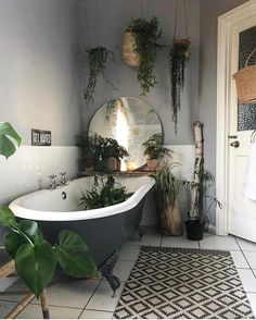 Love all the plants in this bathroom