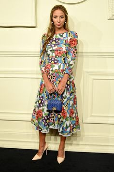 Harley Viera-Newton in a printed 3 quarter sleeve dress and point-toe pumps at Chanel's Paris-Salzburg show in NYC
