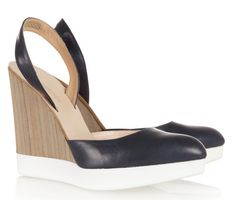 I love the airiness of these wedges, which normally come off heavy and chunky looking.  The white bottom makes the foot appear like it's floating, and the pale color of the wooden wedge in contrast to the black slingback makes the heel appear effortlessly lifted.  Jil Sander at Net-a-Porter.
