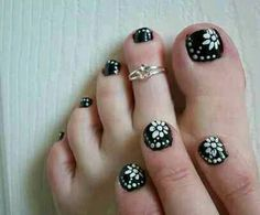 Black and silver flowers manicure and pedicure