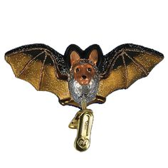 "Clip on Bat Christmas Ornament 12308 Merck Family's Old World Christmas Introduced 2011 Measures approximately 4 1/2"" Mouth blown, hand painted, glass Christmas ornament from Merck"