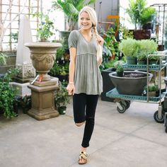 Lightweight knit top with v-neck, front peplum and short sleeves  Approximate bust measurement:  Small – 34″      Medium – 36″      Large – 38″  Approximate length:  Small – 27.5″  Medium – 28″  Large – 28.5″