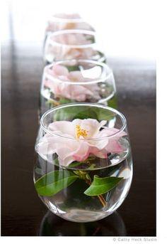 Such a simple, yet elegant flower arrangement! It is also fun to float camellias on a platter or in hurricane lanterns. // CathyHeckNurseryArt.com- #Camellias #SimpleFlowerArrangement