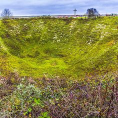 Lochnagar Crater. This crater was created on the first day of the battle of the Somme on 1 July 1916 when the British blew a mine under the German front line.. It was caused by exploding 27 000kg of ammonal and is 91m across and 21m deep. For some idea of the size the cross in the background is the same as the cross in the pic before this one. @ww1cc - here is my pic as requested. Thanks for asking #somme #ww1centenary #lochnagarcrater #visitfrance