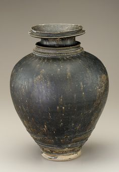 Cambodia, during the Angkor period, 12-13th Century.  This looks like the jars I saw in the Cambodian Museum of Art where we were asked not to take photos.